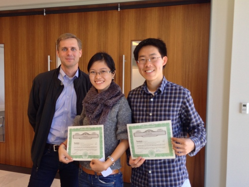 Justin, Thuy, and Elliot with Greengar Stock Certificates